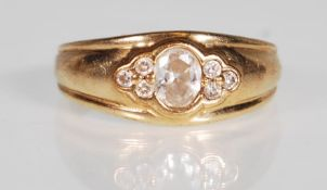 A hallmarked 9ct gold and CZ band ring. The ring h