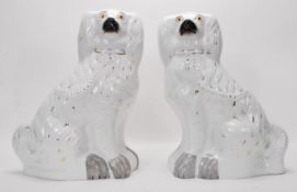 A pair of 19th Century large Staffordshire firesid