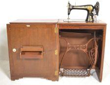 A 1930's Art Deco oak Singer Sewing machine cabine