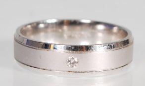 An English hallmarked 9ct white gold band ring hav