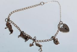 A small silver charm bracelet having a total of fo
