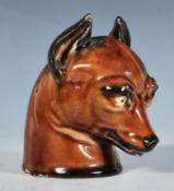 A 19th Century hunting interest ceramic stirrup cu