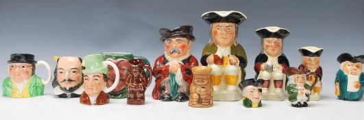 A collection of thirteen 20th Century Toby jugs of