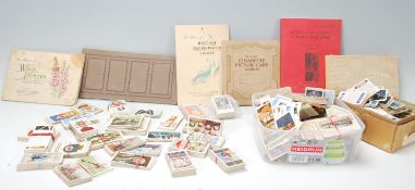 A collection of cigarette cards to include full an