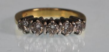 A stamped 18ct white gold five stone ring set with