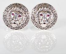 A pair of gentleman's silver cufflinks of round fo
