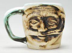 A Devon studio art pottery mug signed Andre Loret