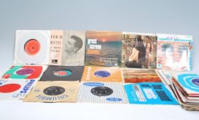 """A collection of 45rpm 7"""" vinyl singles dating from"""