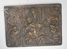 A 20th Century cast brass wall plaque having embos