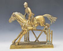 A 20th Century brass statue depicting a horse with