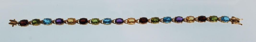 A stamped 14k 14ct gold tennis bracelet set with m