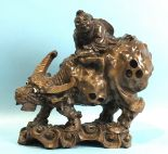Lot 247 - A Chinese carved wood figure of a man on a buffalo, 27cm high, (damaged).