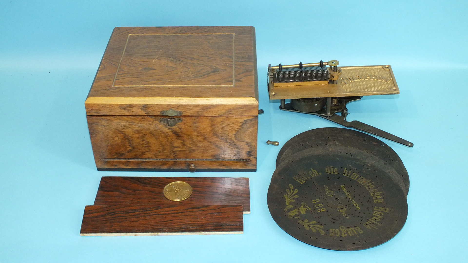 Lot 126 - A small polyphon disc musical box with four discs, in need of restoration.