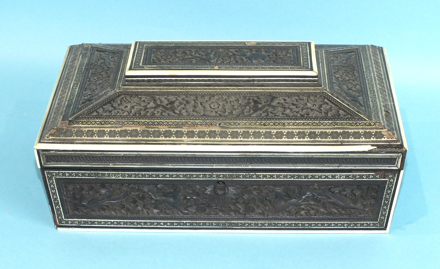 Lot 270 - An Indian sarcophagus shaped Visagapatam work box, with hinged lid fitted with internal mirror and