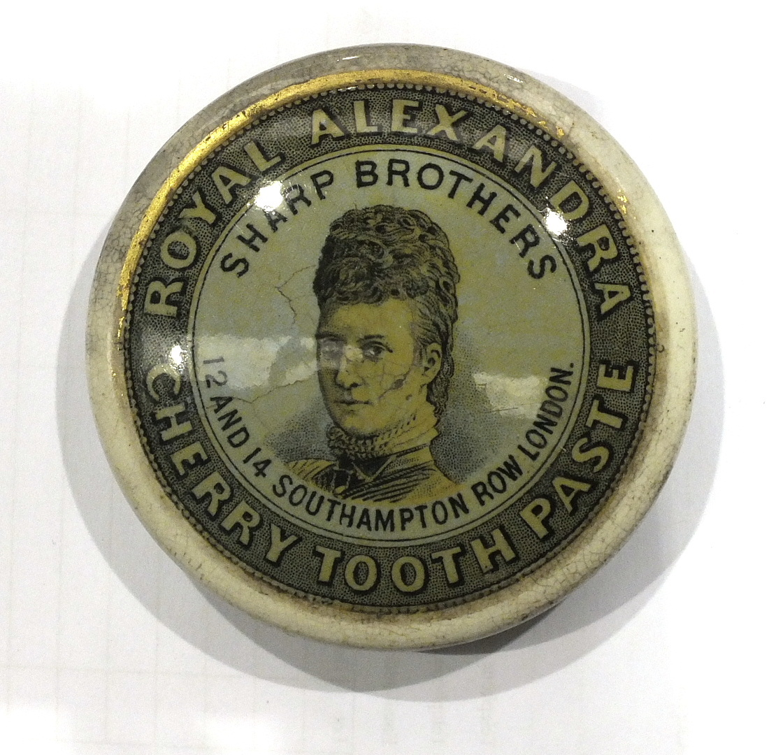 Lot 149 - A Victoria & Albert Napoleon Price & Co. 'Cherry Tooth Paste' printed pot lid and nineteen similar