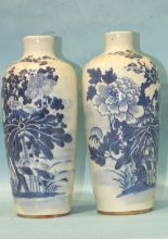 Lot 153 - A pair of 19th century Chinese blue and white slender porcelain vases decorated with aquatic