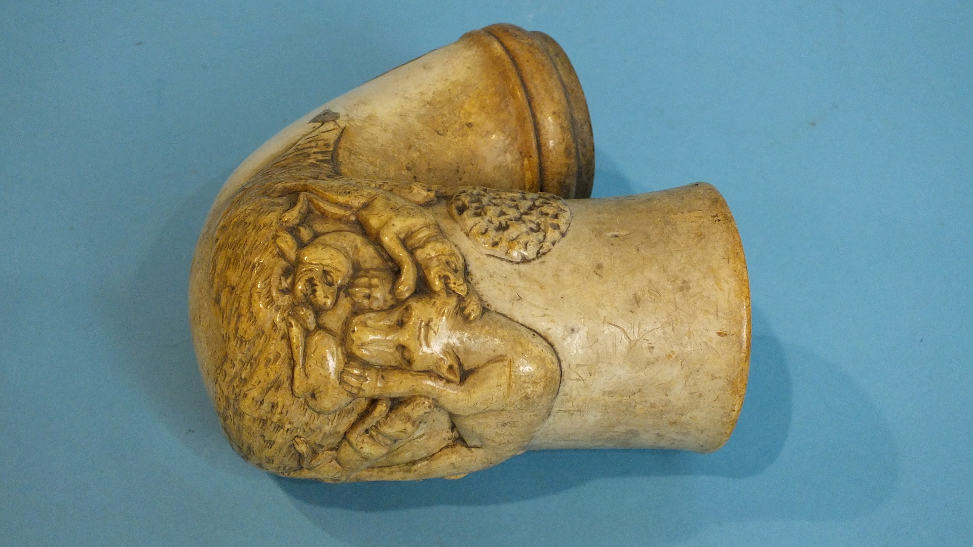 Lot 254 - A 19th century continental meerschaum pipe bowl of large proportions, carved in relief with a pack