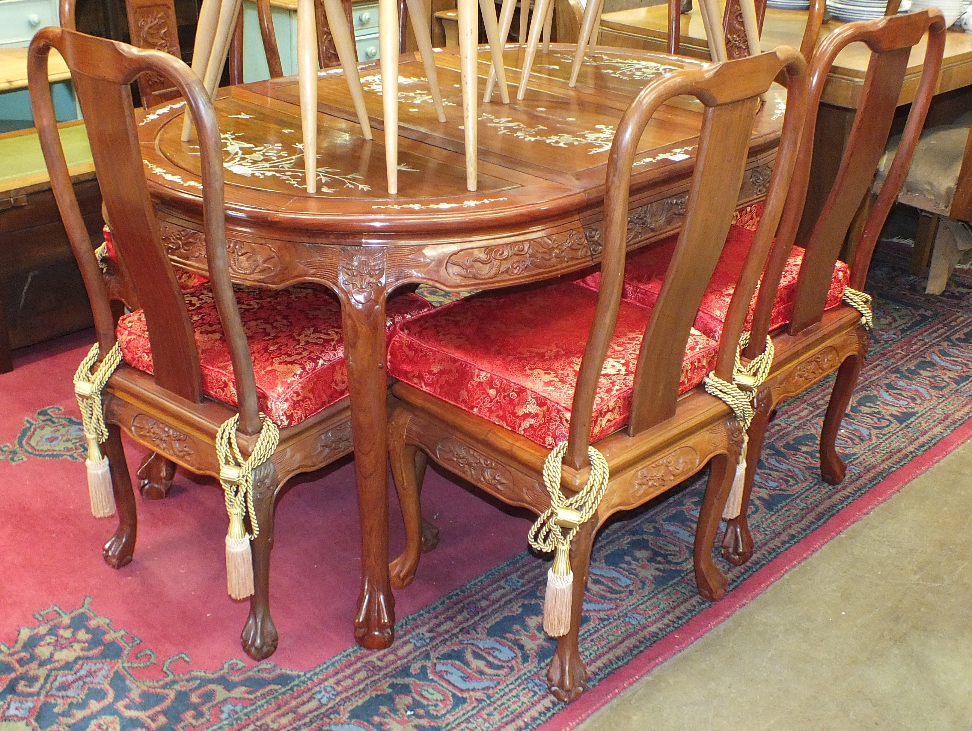 Lot 33 - A modern Oriental hardwood extending dining table on cabriole legs, the top with inlaid decoration