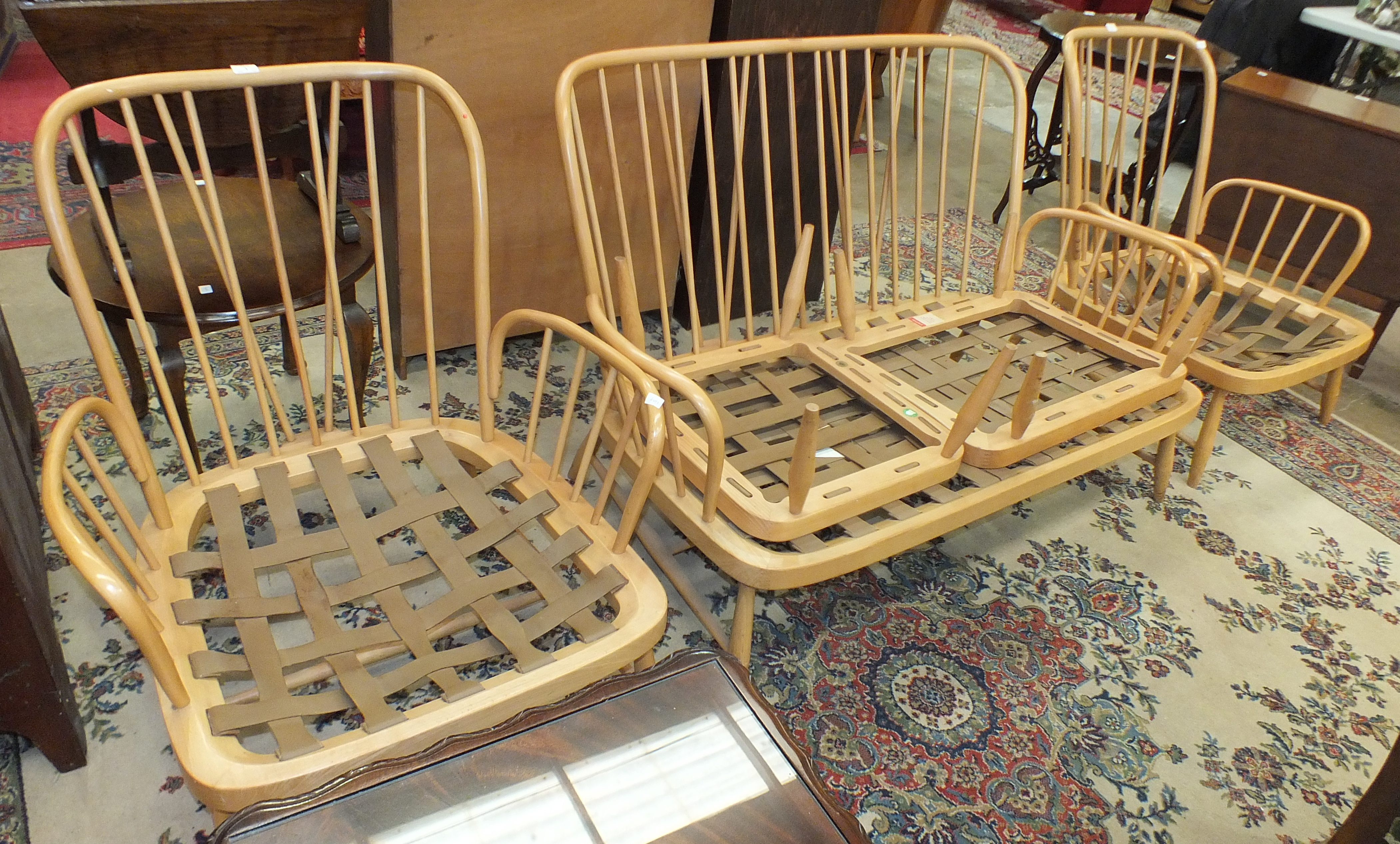 Lot 1 - A vintage Ercol light wood stick-back lounge suite, comprising a two-seater settee, two armchairs