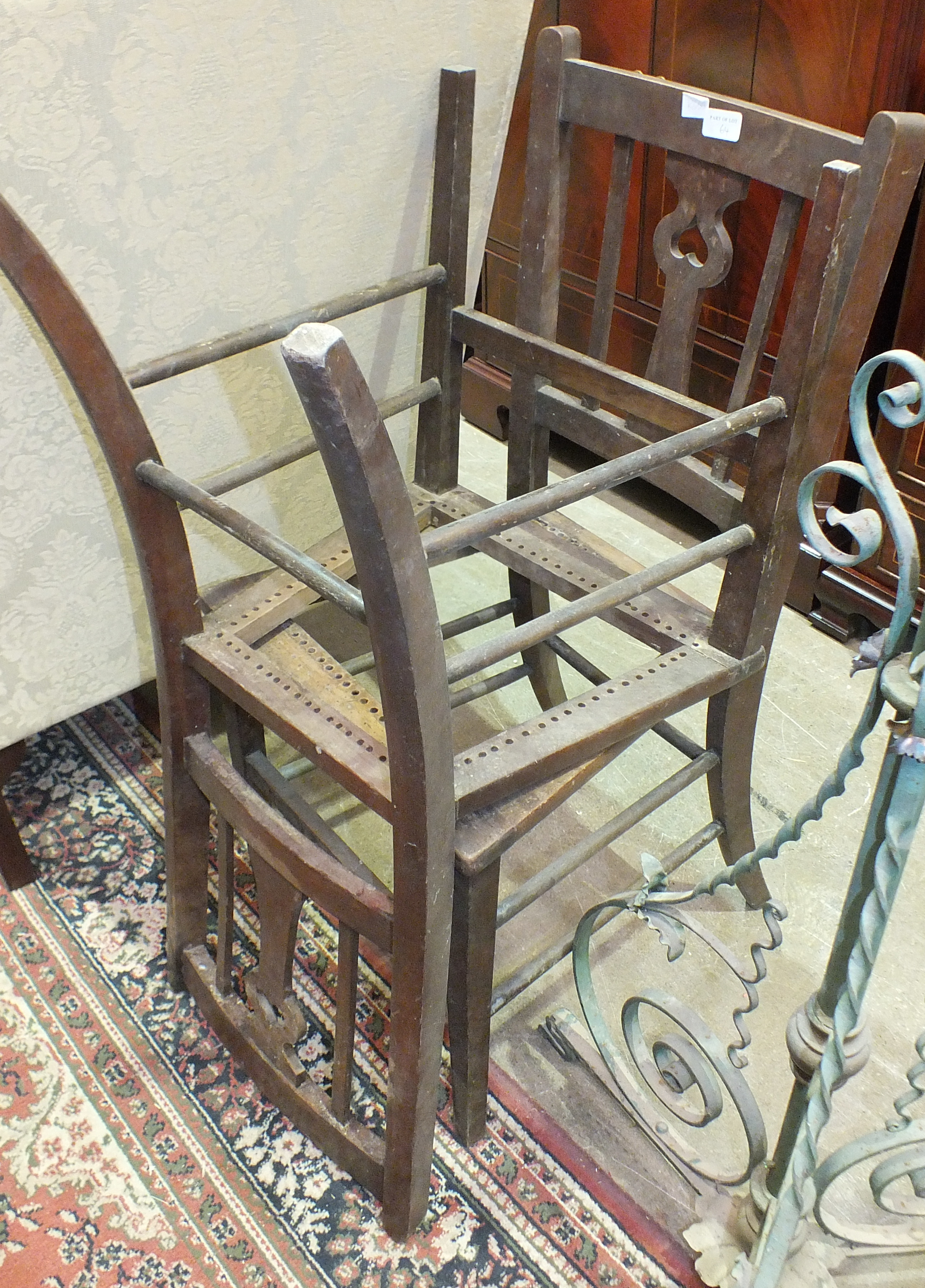 Lot 64 - An oak shoe rack, 70cm wide, two chairs and two metal adjustable lamp standards, (5).