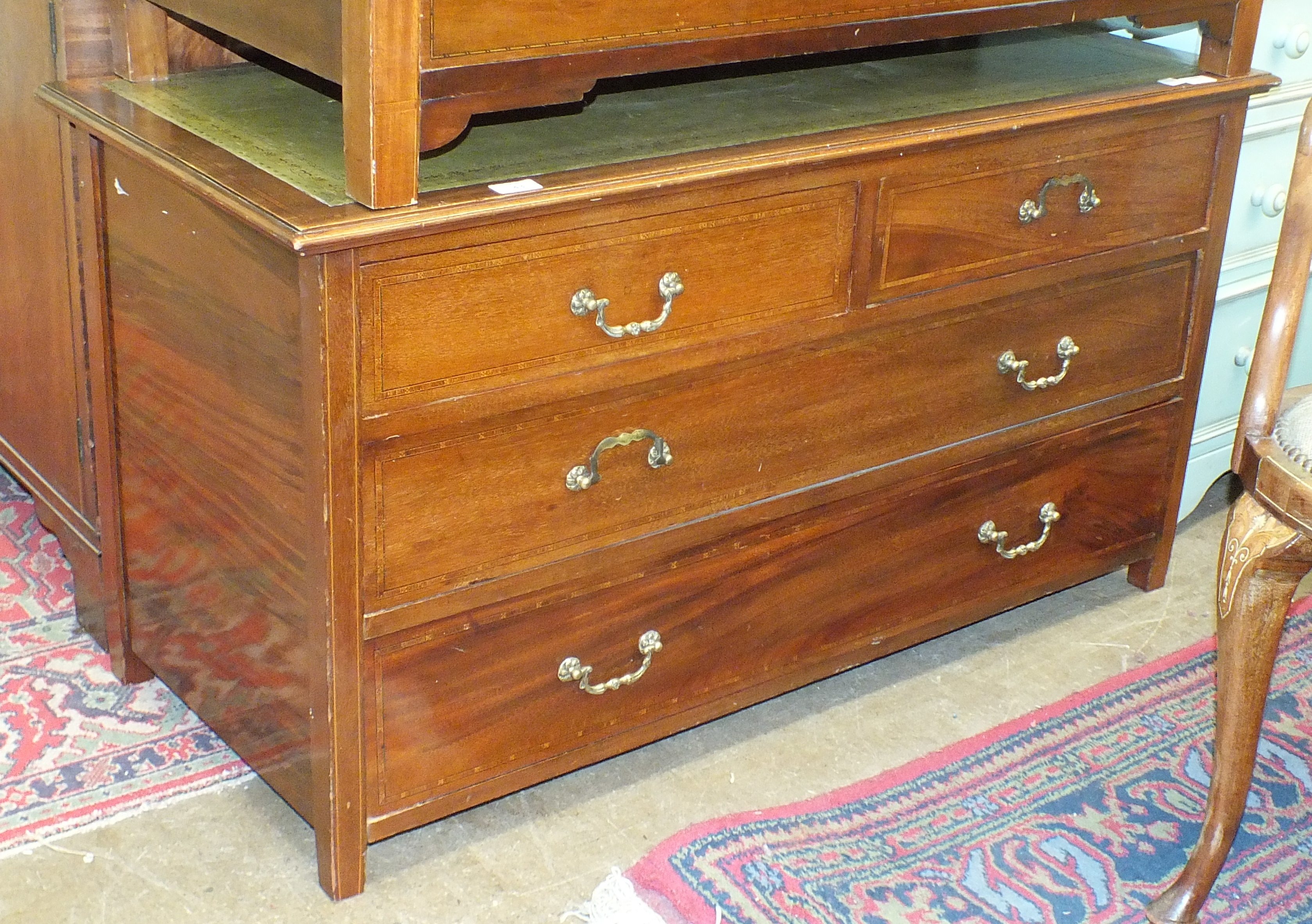 Lot 43 - An inlaid mahogany low chest/table fitted with two short and two long drawers, to rectangular top