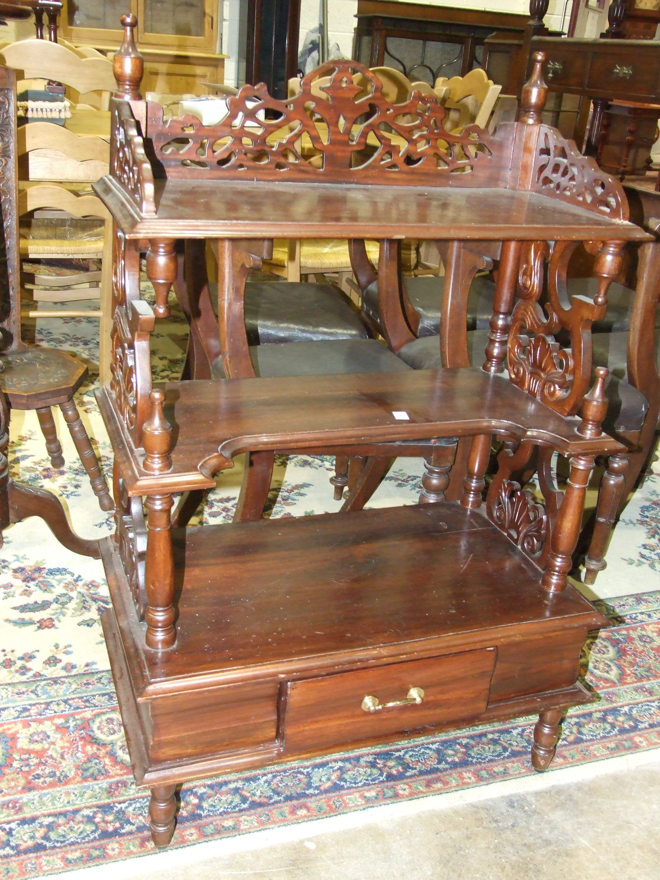 Lot 24 - A reproduction hardwood three-tier whatnot fitted with a drawer, 70 x 180cm and a reproduction