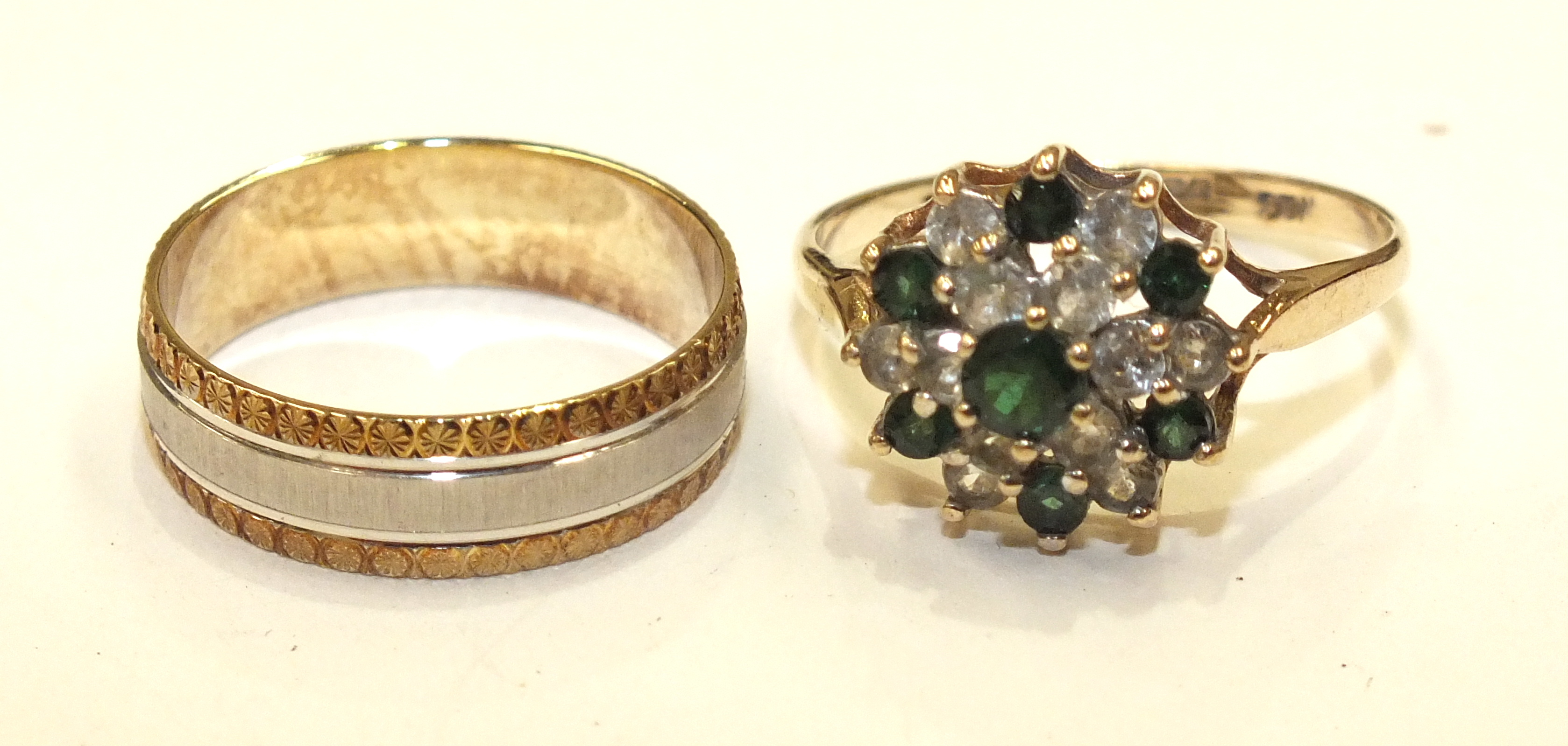Lot 301 - A 9ct gold ring set synthetic green and white stones and a 9ct gold wedding band, 5g, (2).
