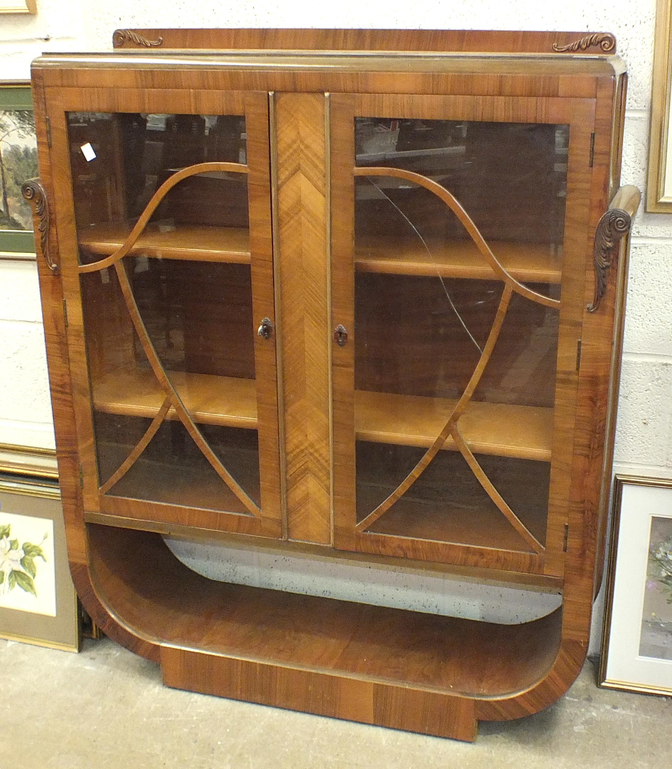 Lot 17 - A 1930's walnut-veneered display cabinet, 110cm wide, 130cm high.
