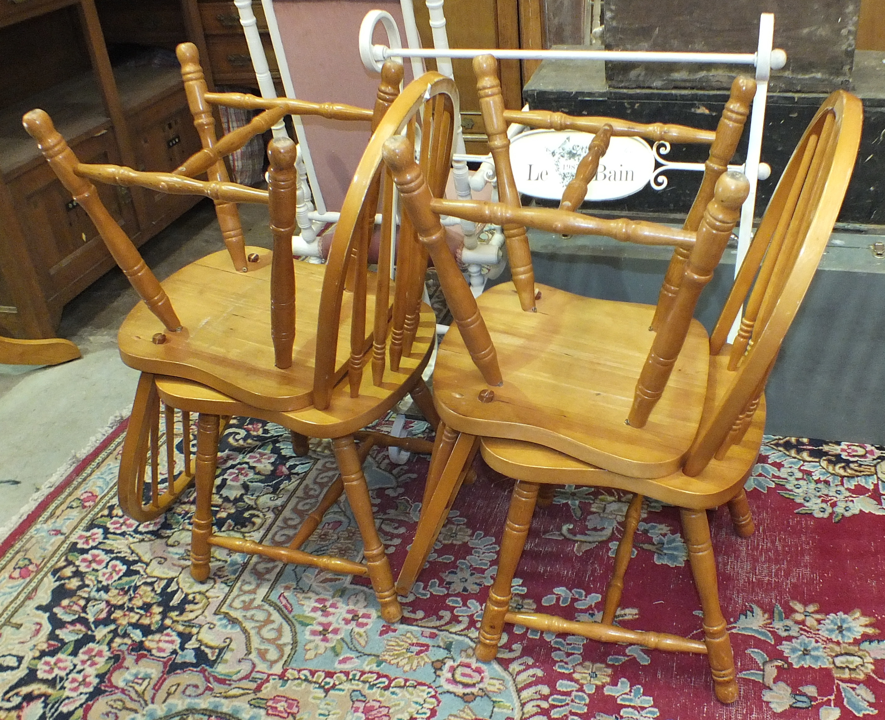 Lot 12 - A quantity of white-painted bedroom furniture, four yellow wood chairs, a circular table, a