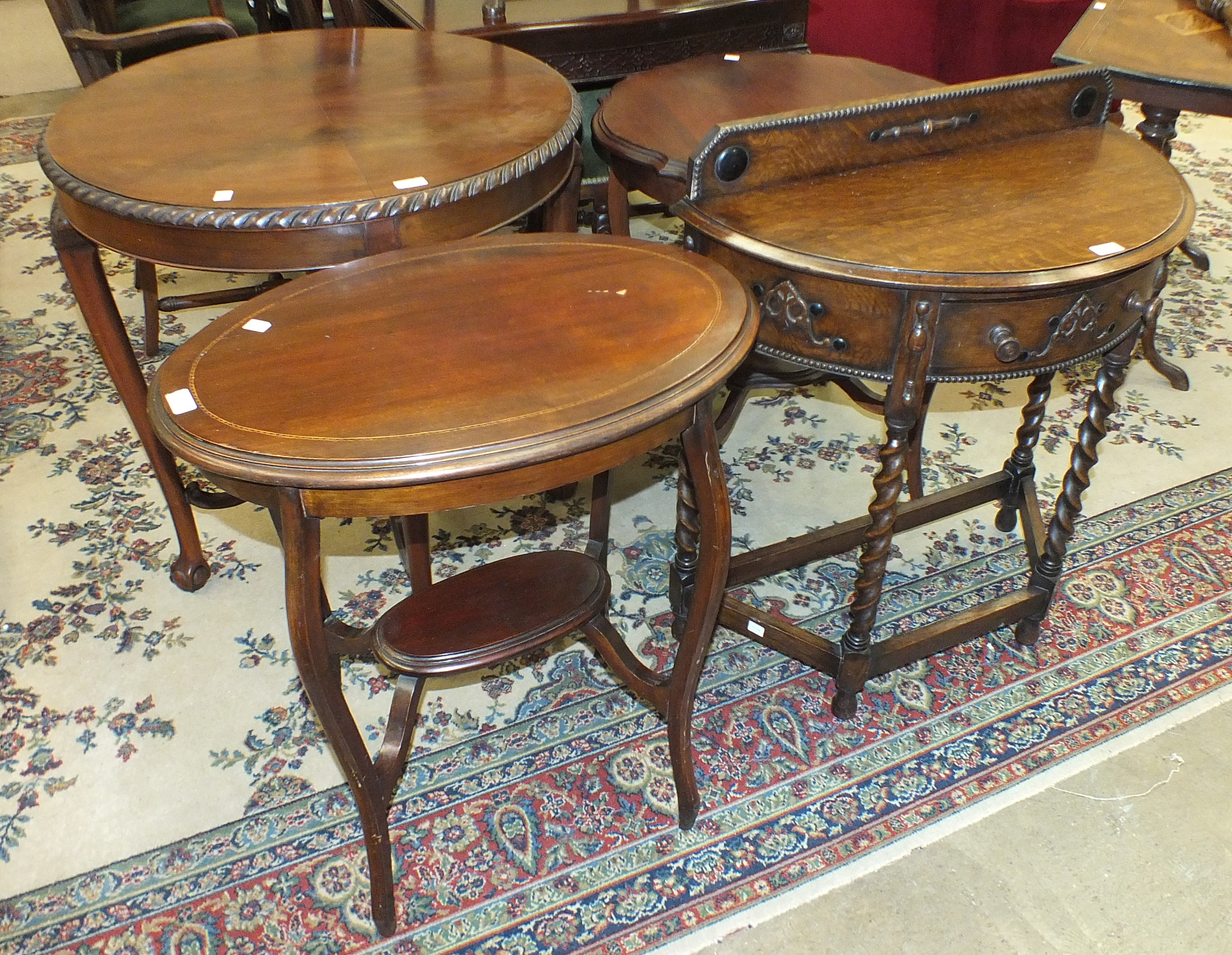 Lot 35 - An Edwardian mahogany circular-top occasional table on slightly-curved turned legs united by an X-