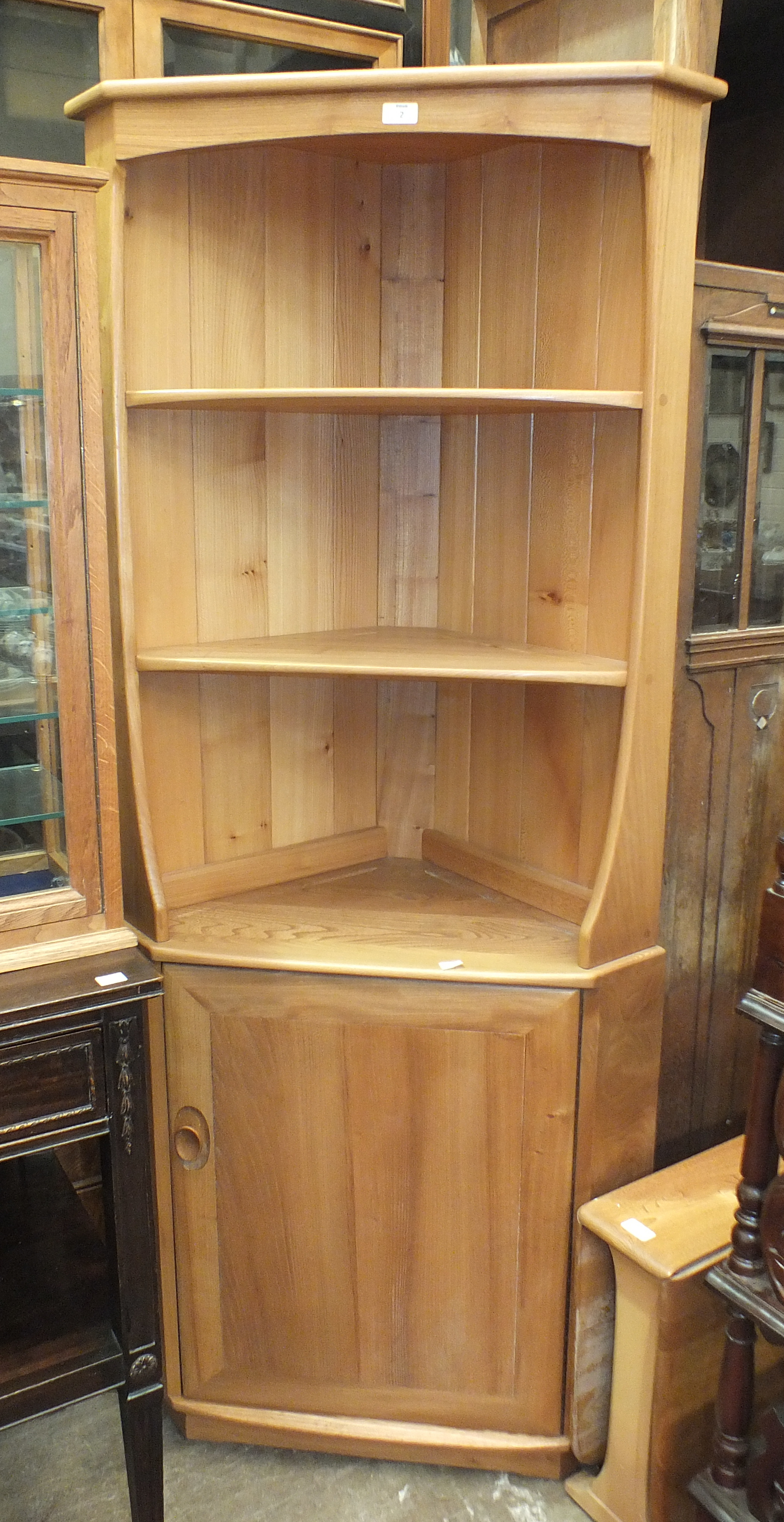 Lot 2 - An Ercol light wood corner shelf unit/cabinet, 76cm wide, 179cm high and a small Ercol-style drop-