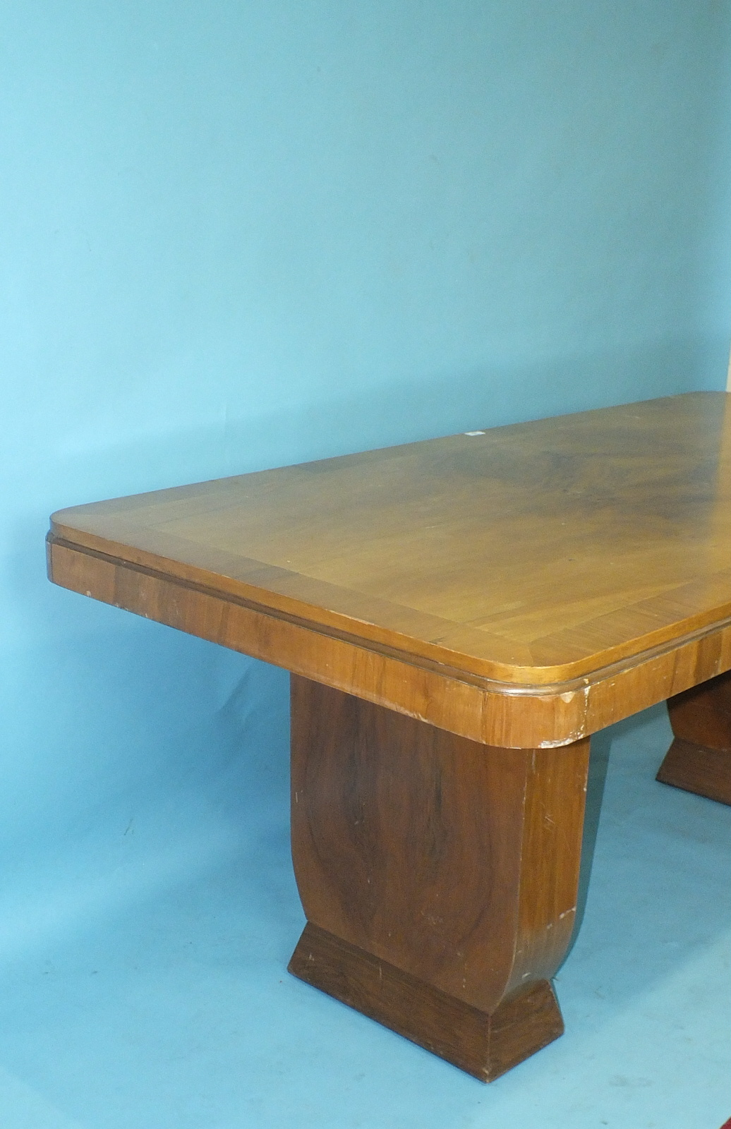 Lot 18 - A 1930's walnut-veneered dining table, 185 x 90cm and five chairs of rounded tub shape.