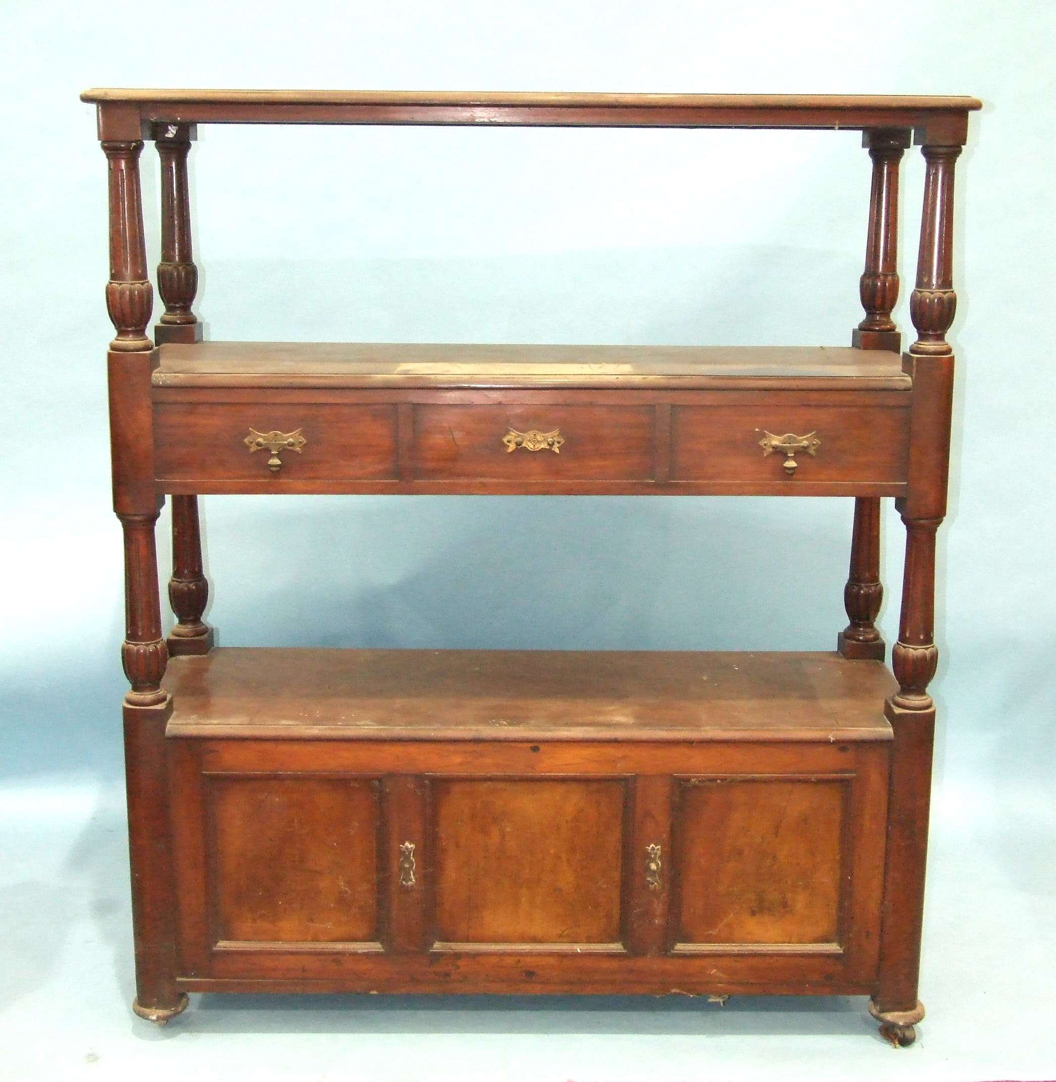 Lot 7 - A Victorian double-sided three-tier dumb waiter, having two centre drawers and three base