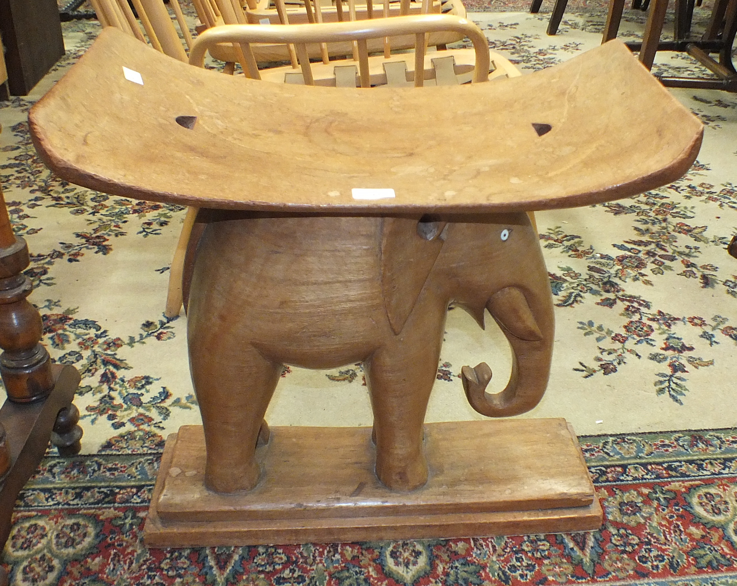Lot 41 - A hardwood elephant stool, 60cm wide, 57cm high and a late-Victorian stained wood and inlaid