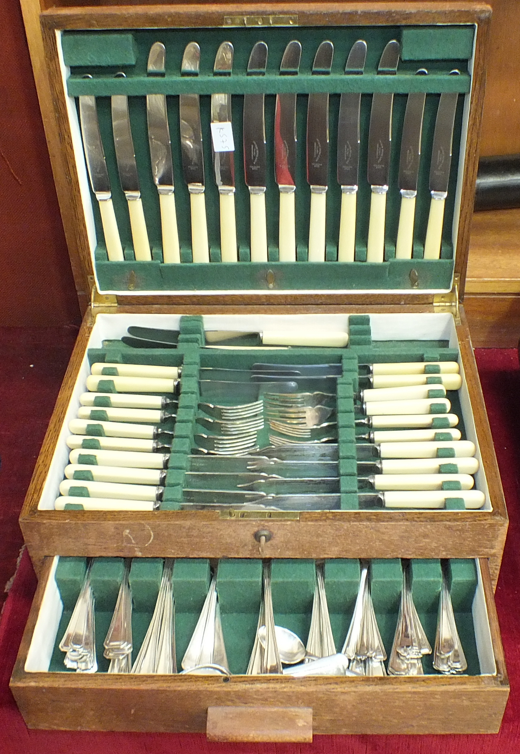 Lot 151 - A part-canteen of cutlery contained in an oak fitted box with drawer.