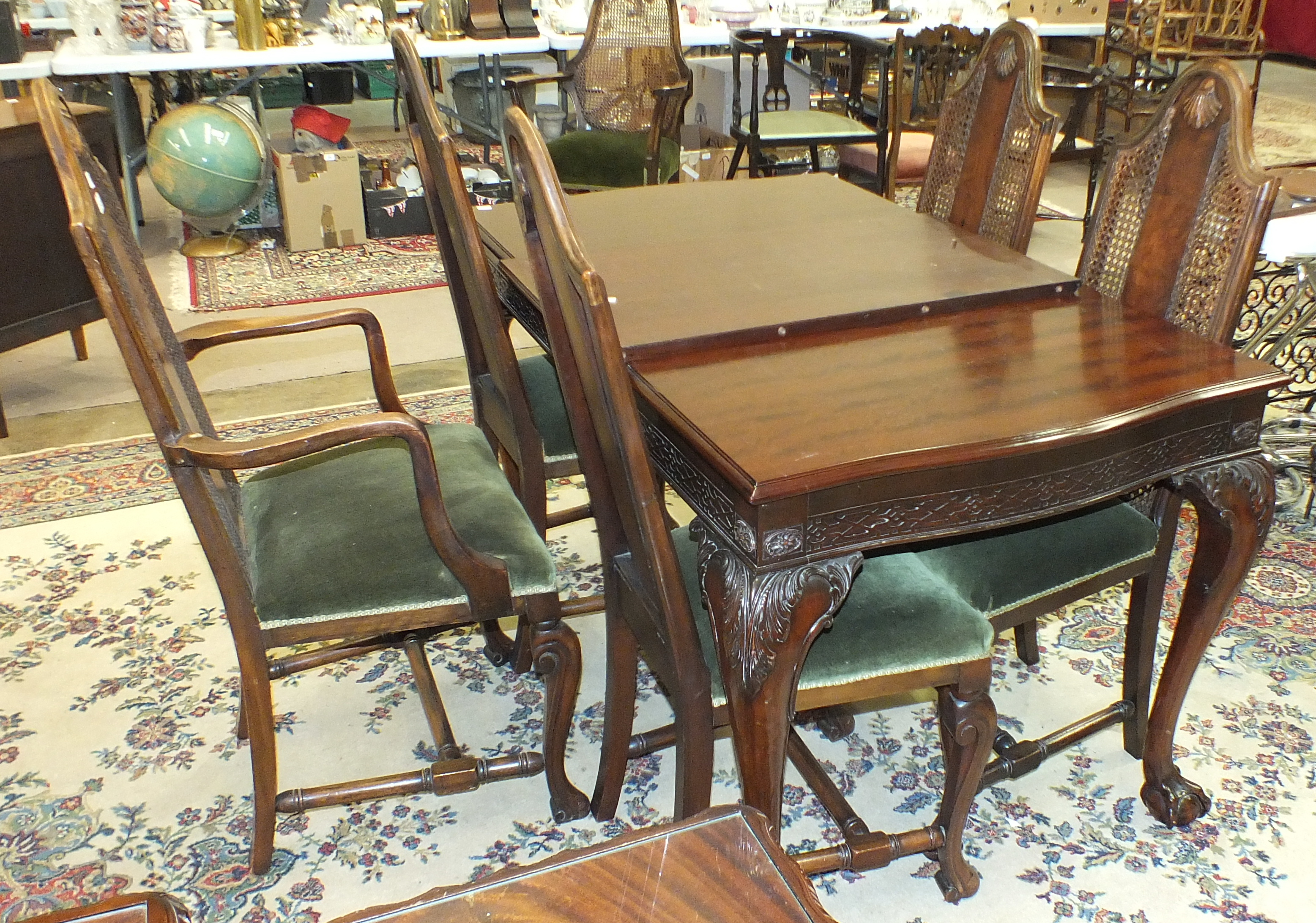 Lot 42 - A set of five late-20th century walnut finish dining chairs with carved backs and upholstered seats,