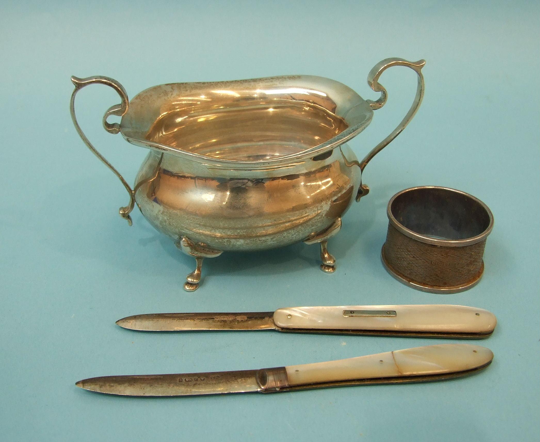 Lot 324 - A silver sugar bowl of bellied form, raised on four pad feet, maker Williams Ltd, Birmingham 1919,