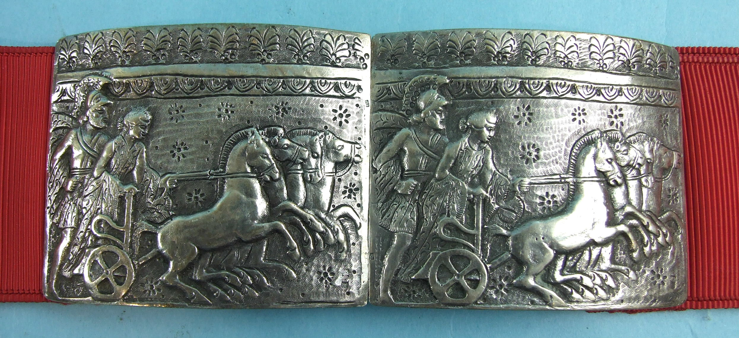 Lot 333 - A Continental white metal buckle of two rectangular plaques, each embossed and engraved with a Greek