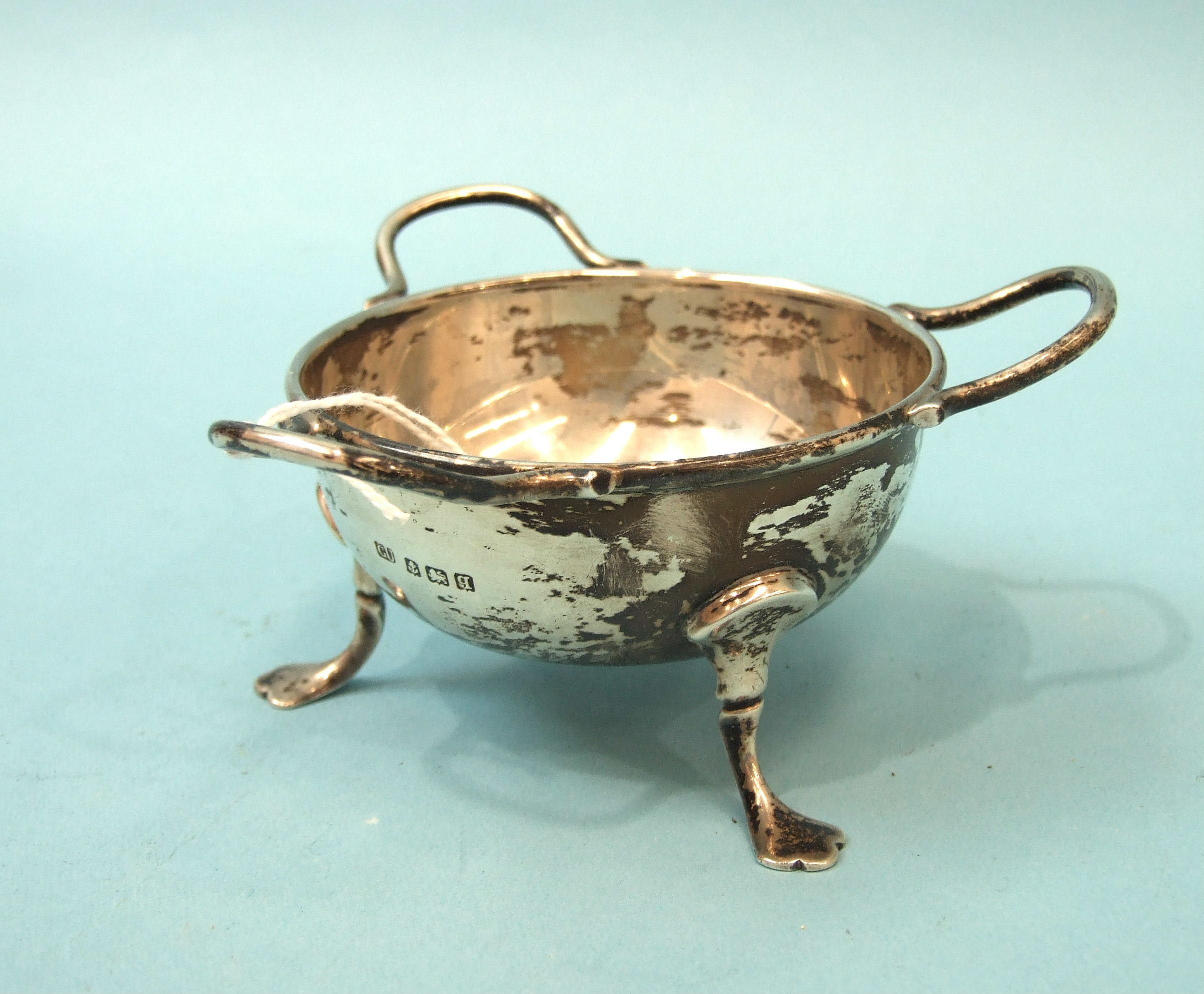 Lot 307 - A silver small circular three-handled bowl on three pad feet, 12cm overall, 6cm high, Birmingham