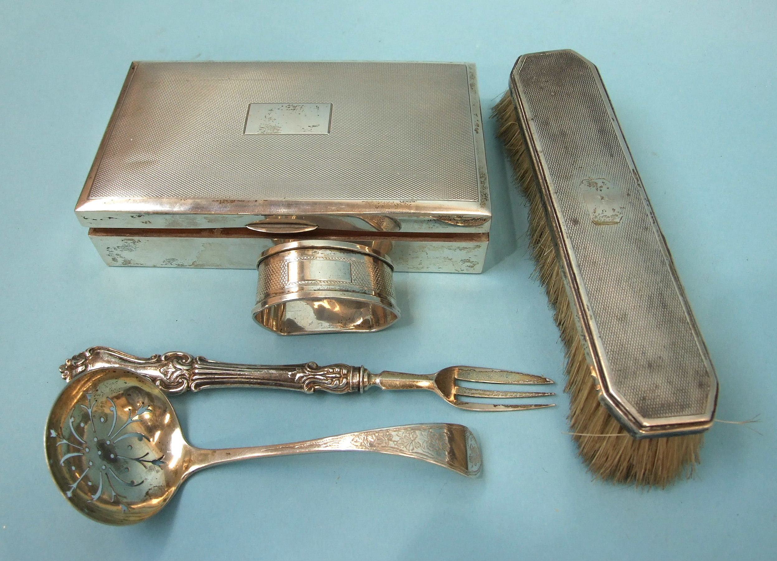 Lot 319 - An engine-turned silver cigarette box, (dented), Birmingham 1935, 9 x 15 x 3.5cm, a silver sifter