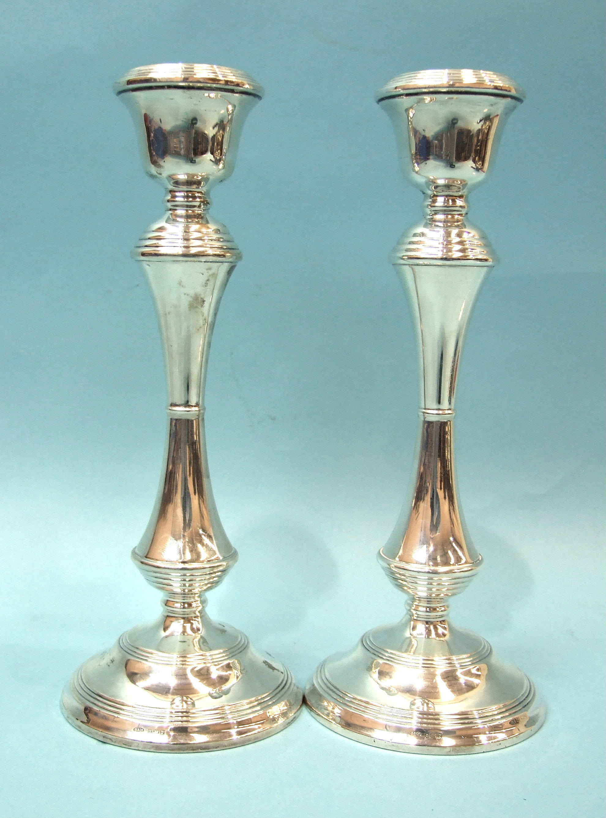 Lot 325 - A pair of modern silver candlesticks with knopped stems and round bases, maker WI Broadway & Co,