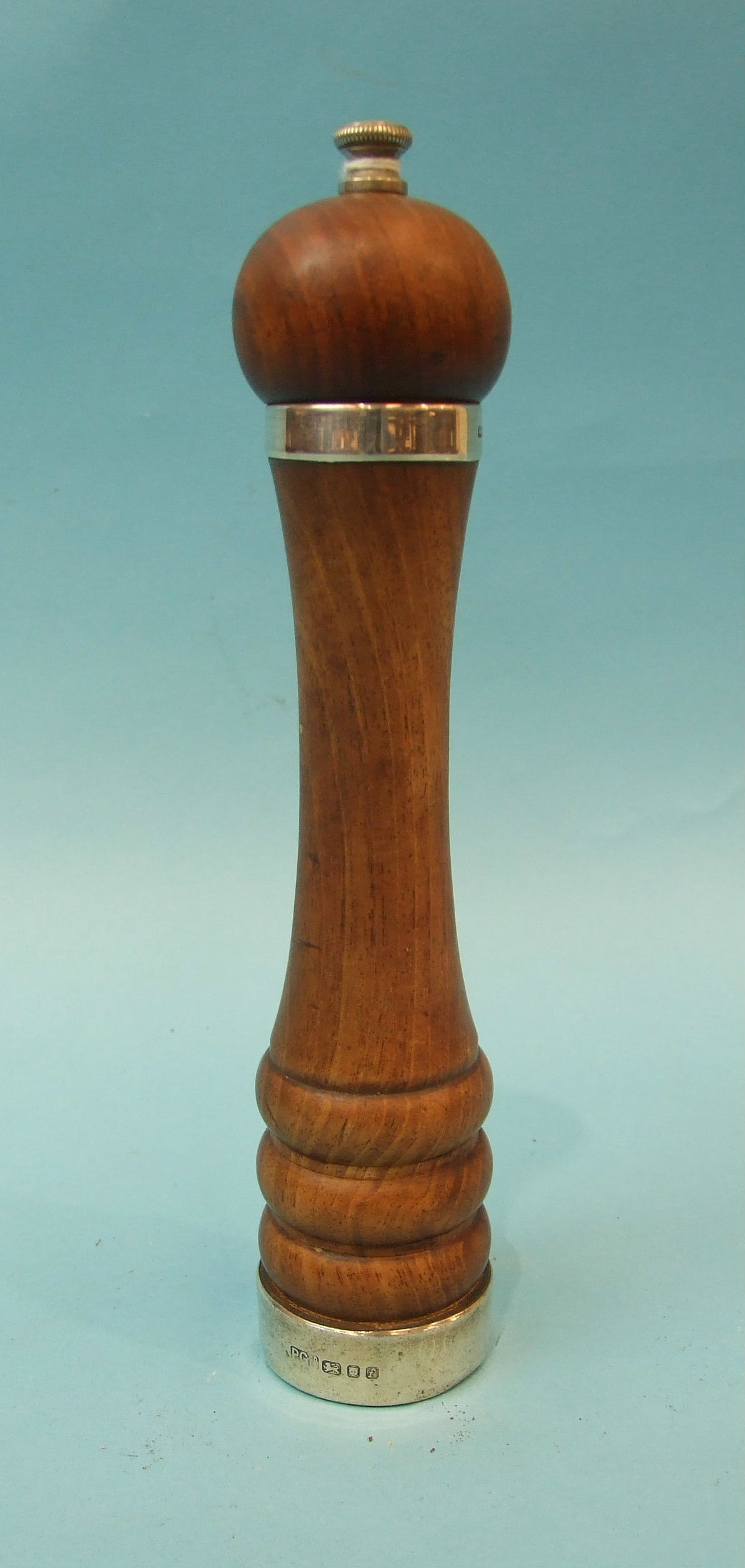 Lot 338 - A modern silver-mounted walnut pepper grinder, maker Park Green & Co, Ltd, London 1961, 23cm.