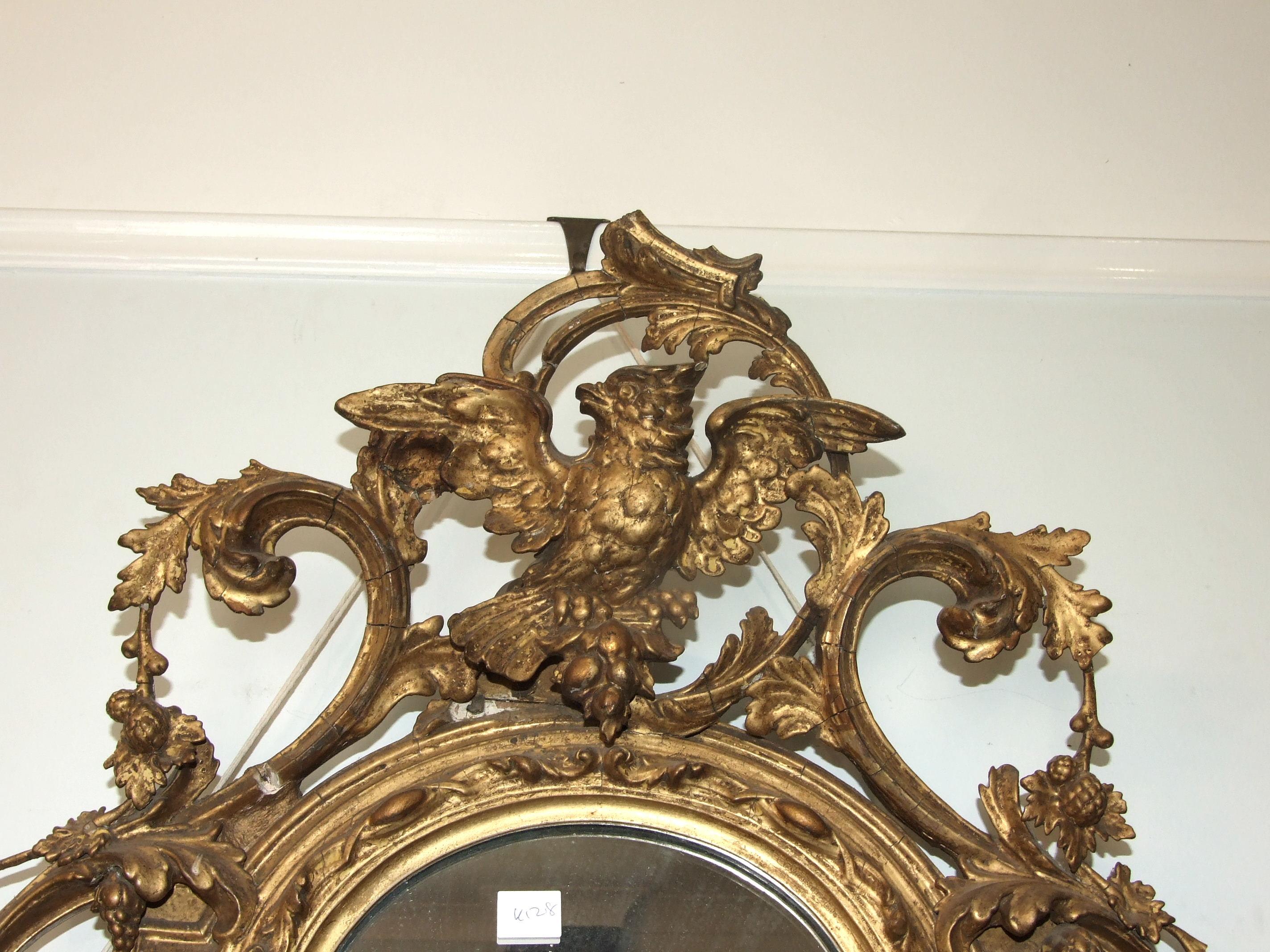 Lot 87 - A Victorian gilt gesso girandole mirror, the foliate pierced frame surmounted by a phoenix and