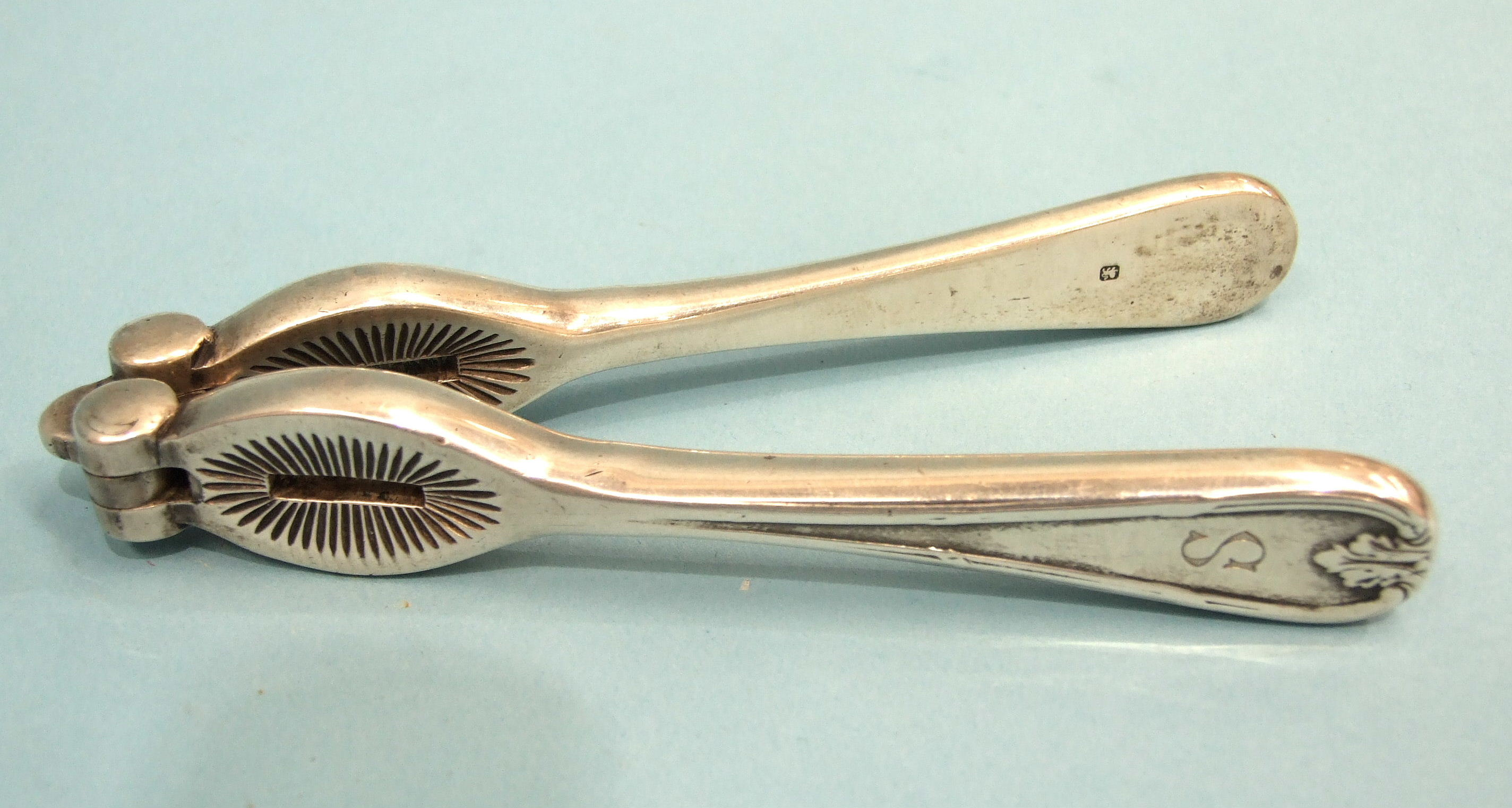 Lot 314 - A pair of Mappin & Webb solid silver nutcrackers, Sheffield 1913, ___7.4oz.
