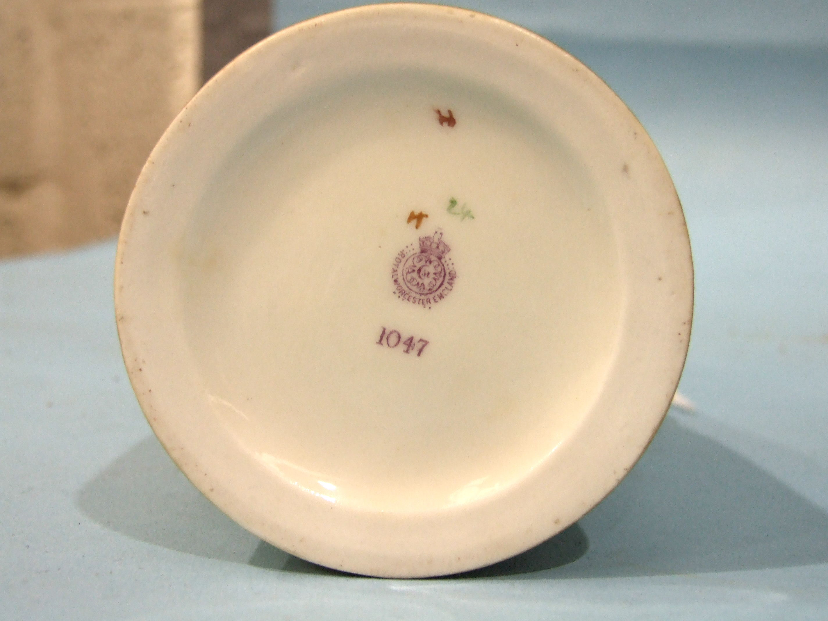 Lot 104 - A Royal Worcester blush ivory tapering cylindrical jug, printed and painted with flowers in