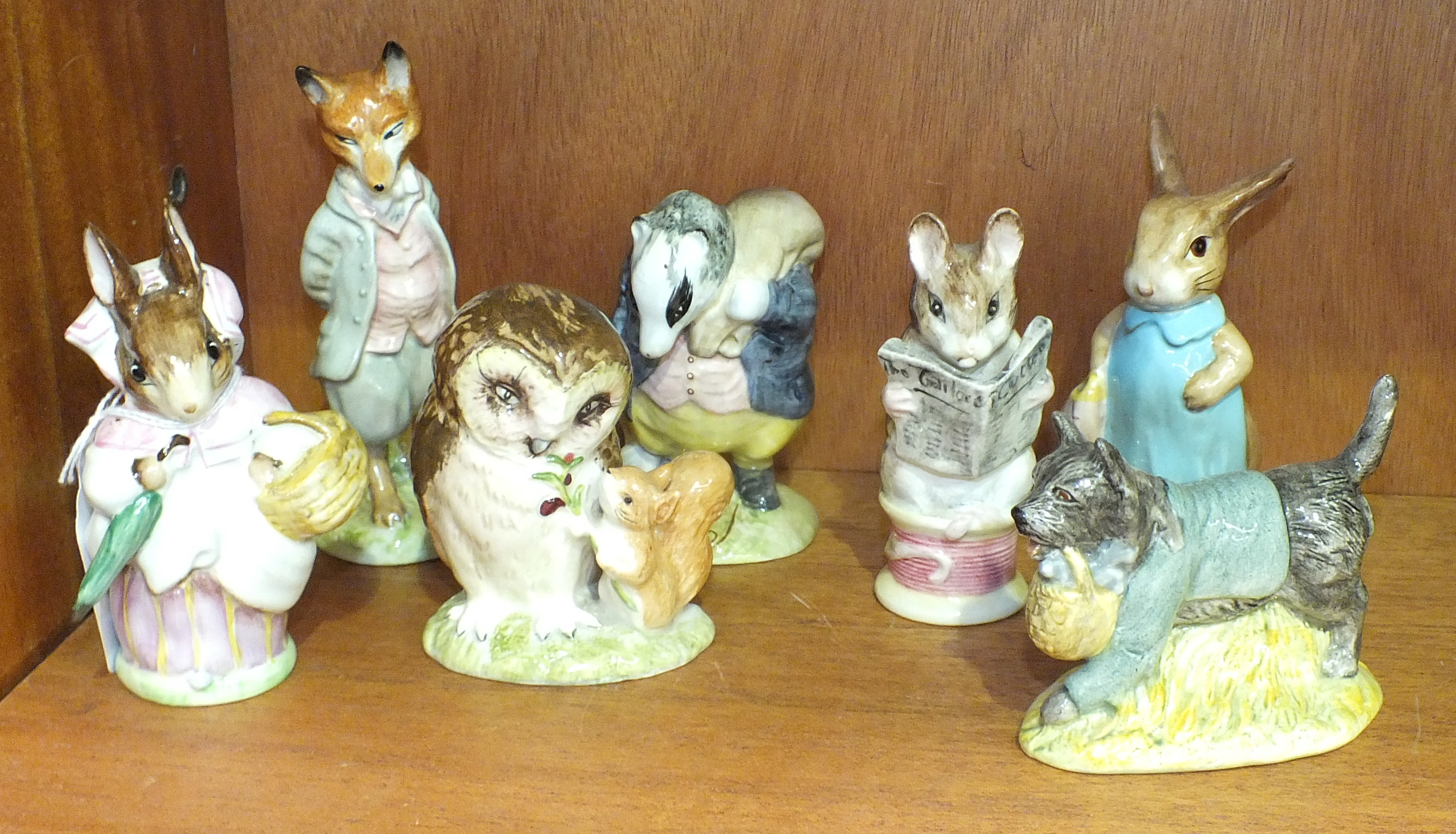 Lot 109 - Four Beswick Beatrix Potter figures, 'Foxy Whiskered Gentleman', 'Mrs Rabbit', 'Tommy Brock' (