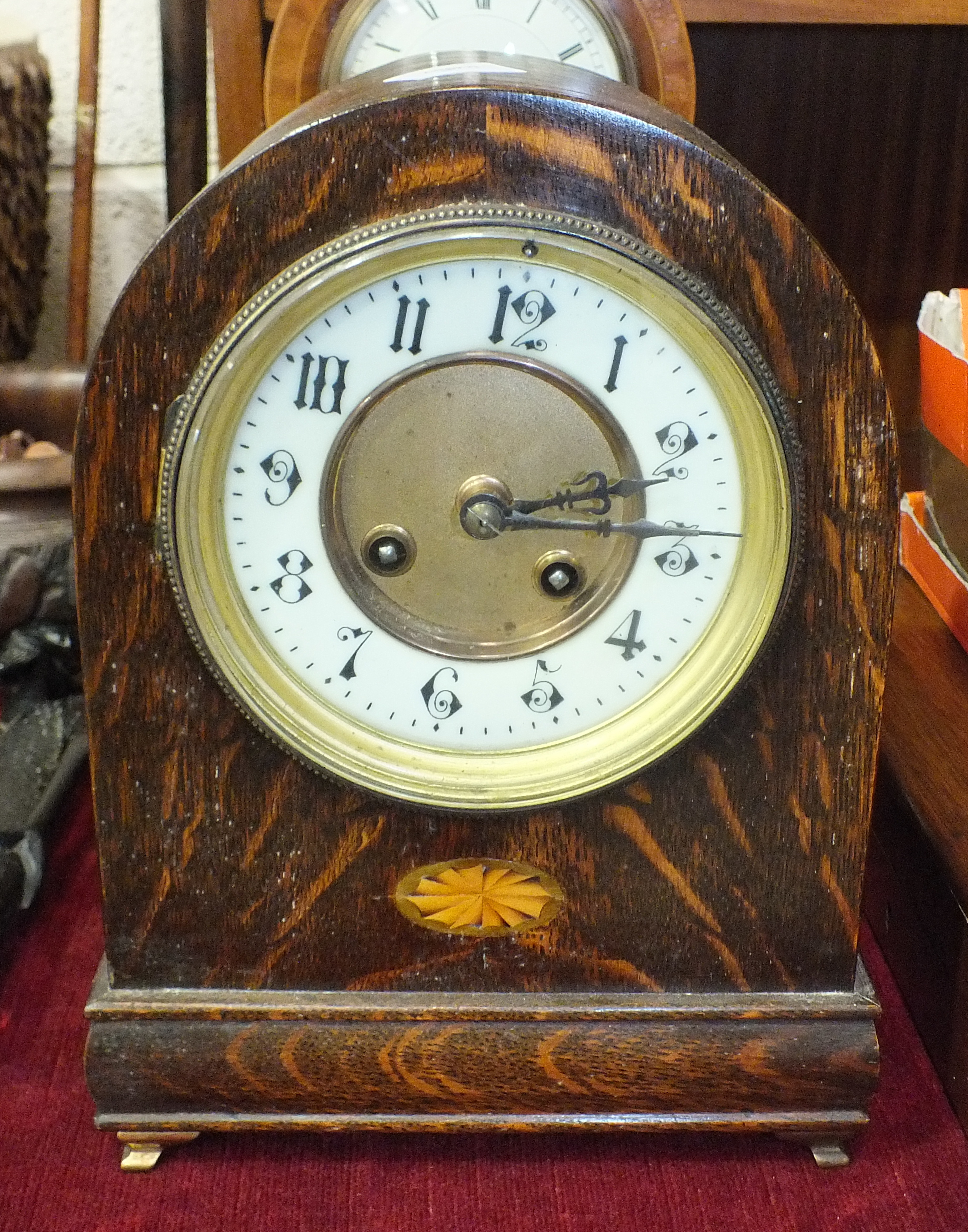 Lot 92 - An inlaid mahogany balloon shape mantel timepiece, the dial marked Speed, Kings Lynn, 30.5cm high