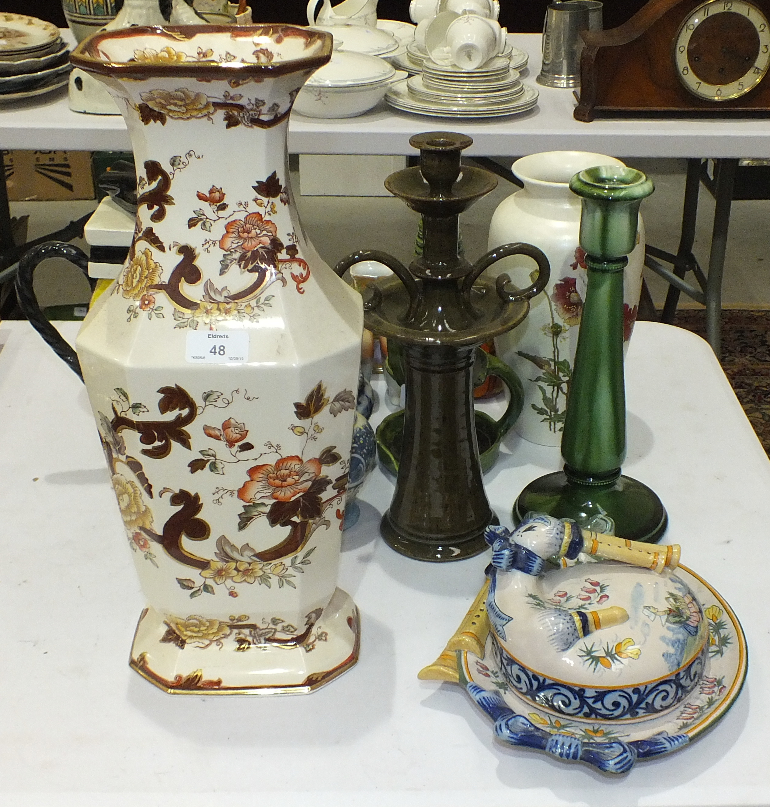 Lot 48 - A Poole Pottery baluster vase decorated with poppies, 26cm high, a ceramic Liquorice Allsort teapot,