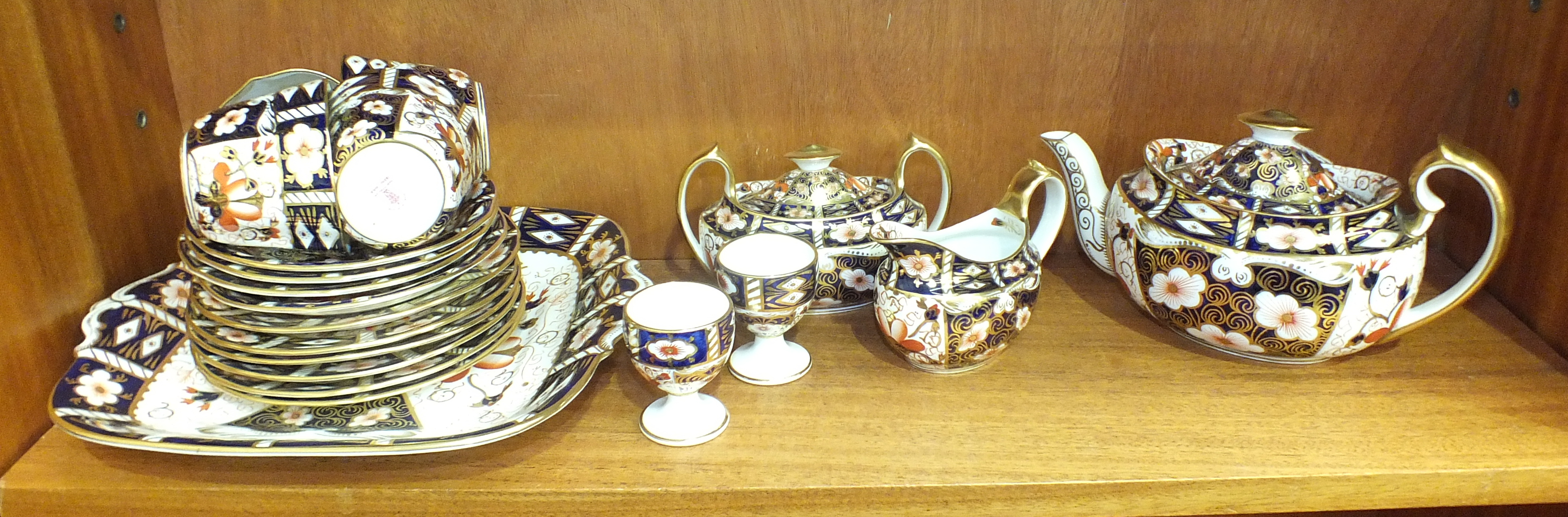 Lot 107 - Eighteen pieces of Royal Crown Derby Imari-decorated tea ware, pattern no. 2451 and two Mintons