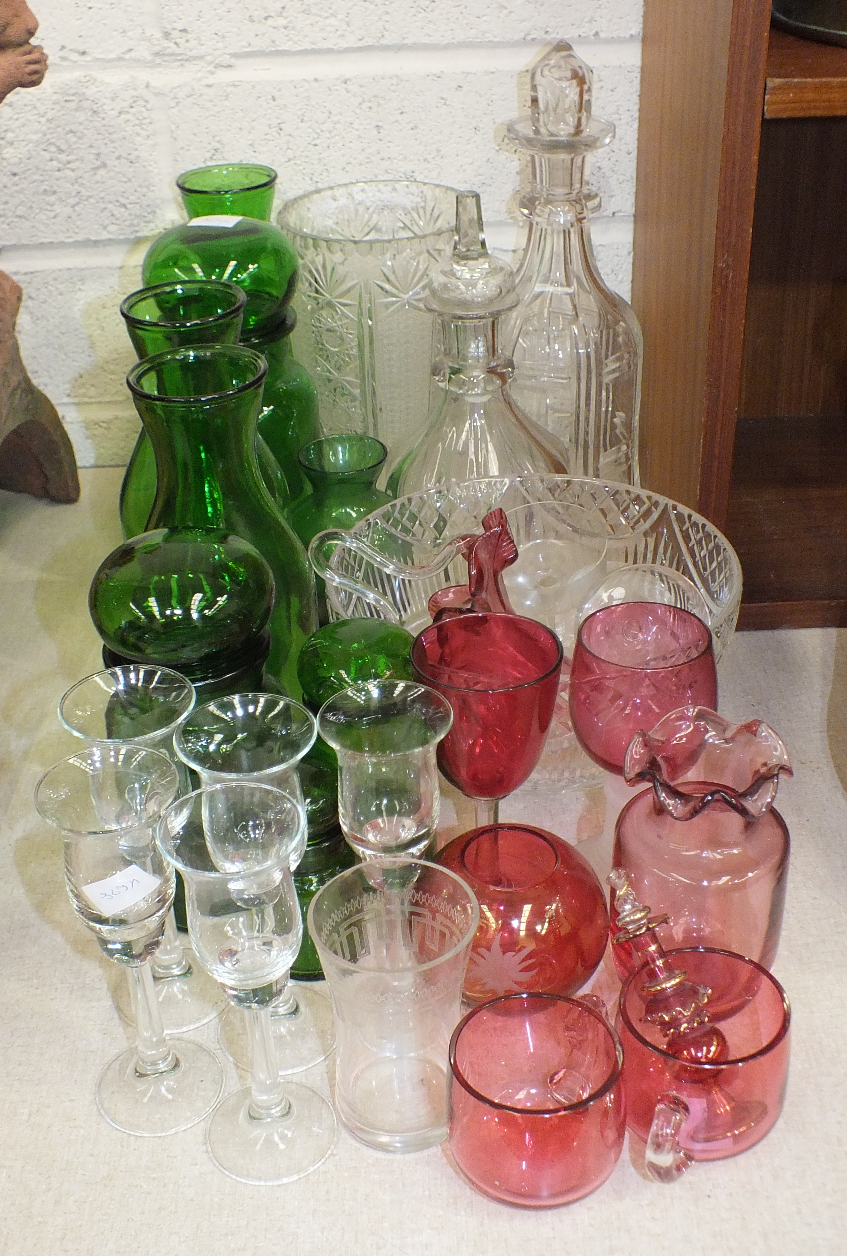 Lot 61 - A small quantity of coloured and clear glassware, including two decanters, green glass vases and